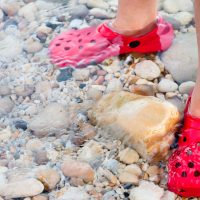 Kids Crocs in Water; Courtesy of Tom Gowanlock/Shutterstock.com