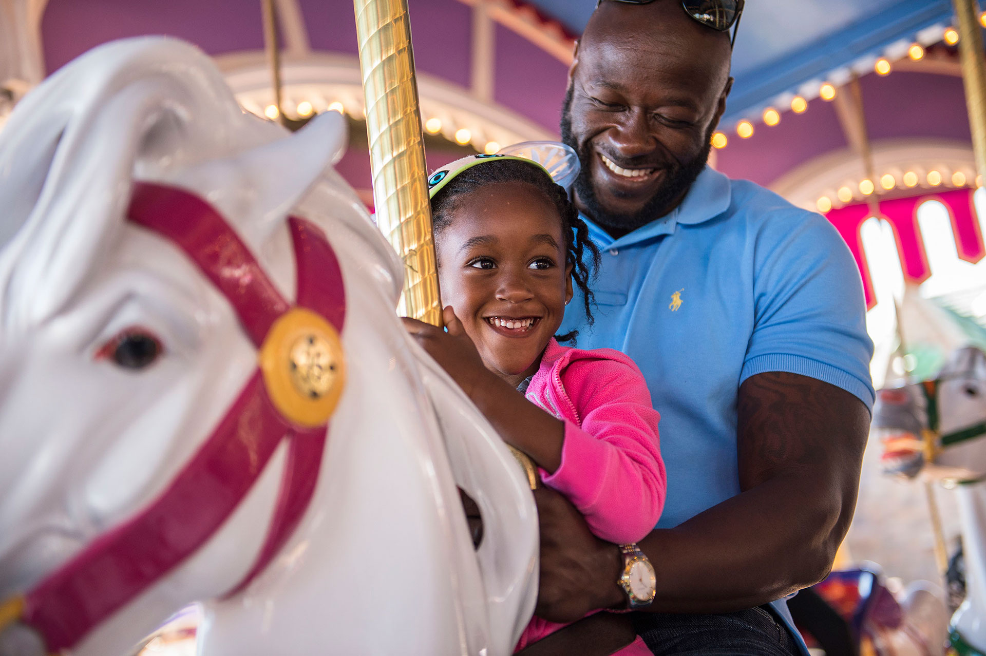 Father and Daughter on Disney World Carousel; Courtesy of Disney