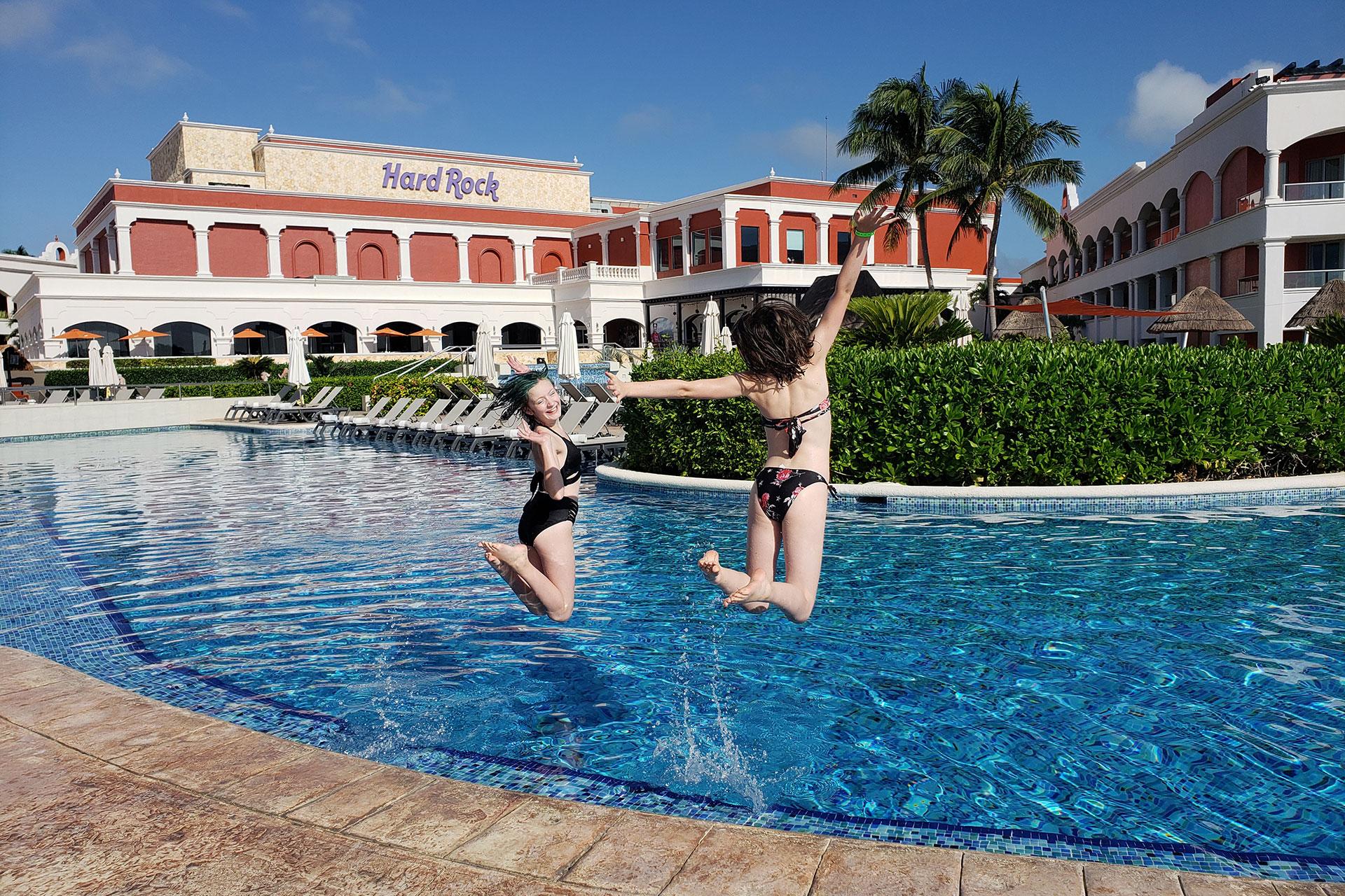 Two Teen Girls Jumping in Pool at Harck Rock Riviera Maya; Courtesy of Jeff Bogle