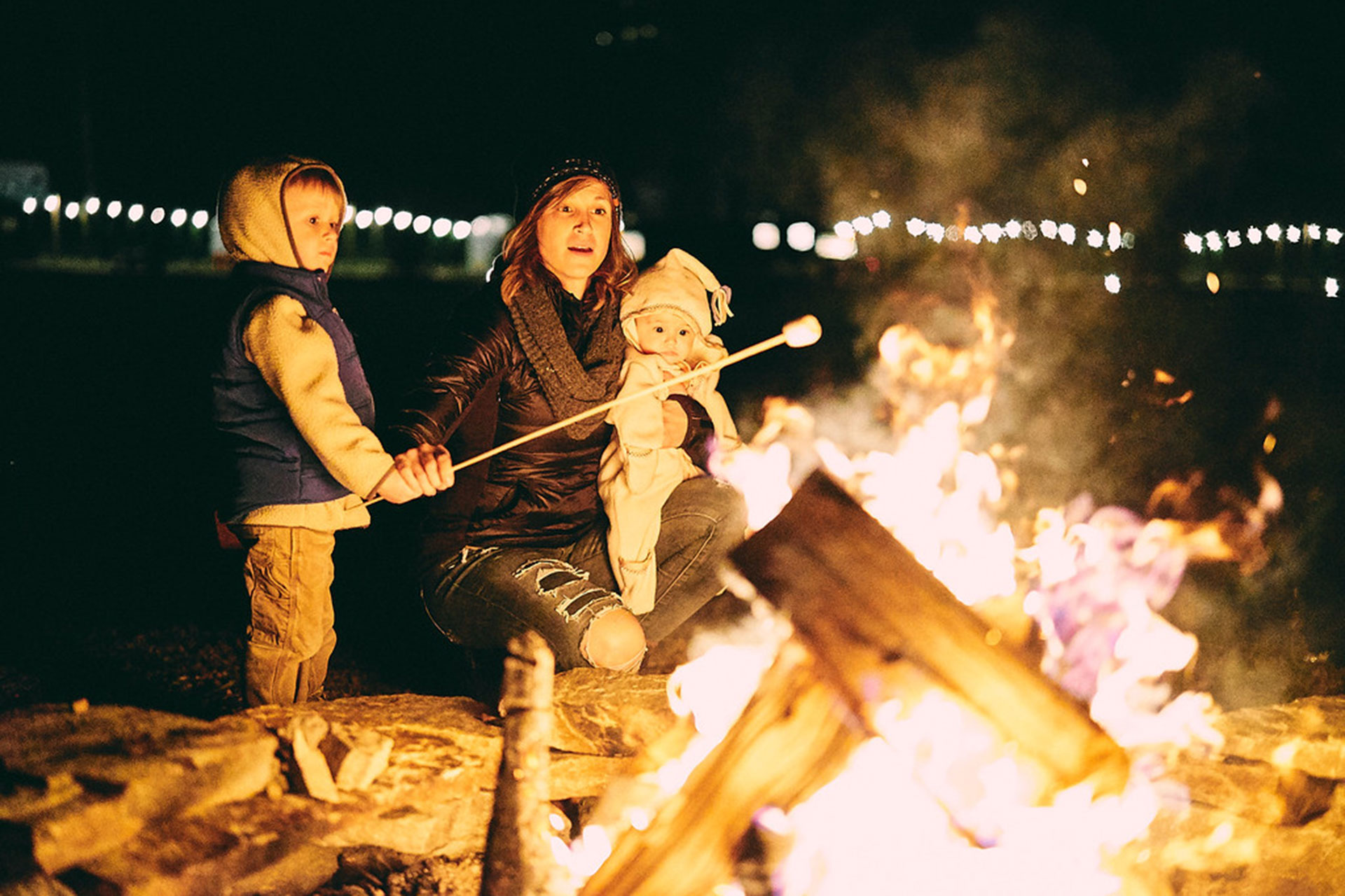 Family Roasting S'mores at JuneBug Retro Resort in North Carolina