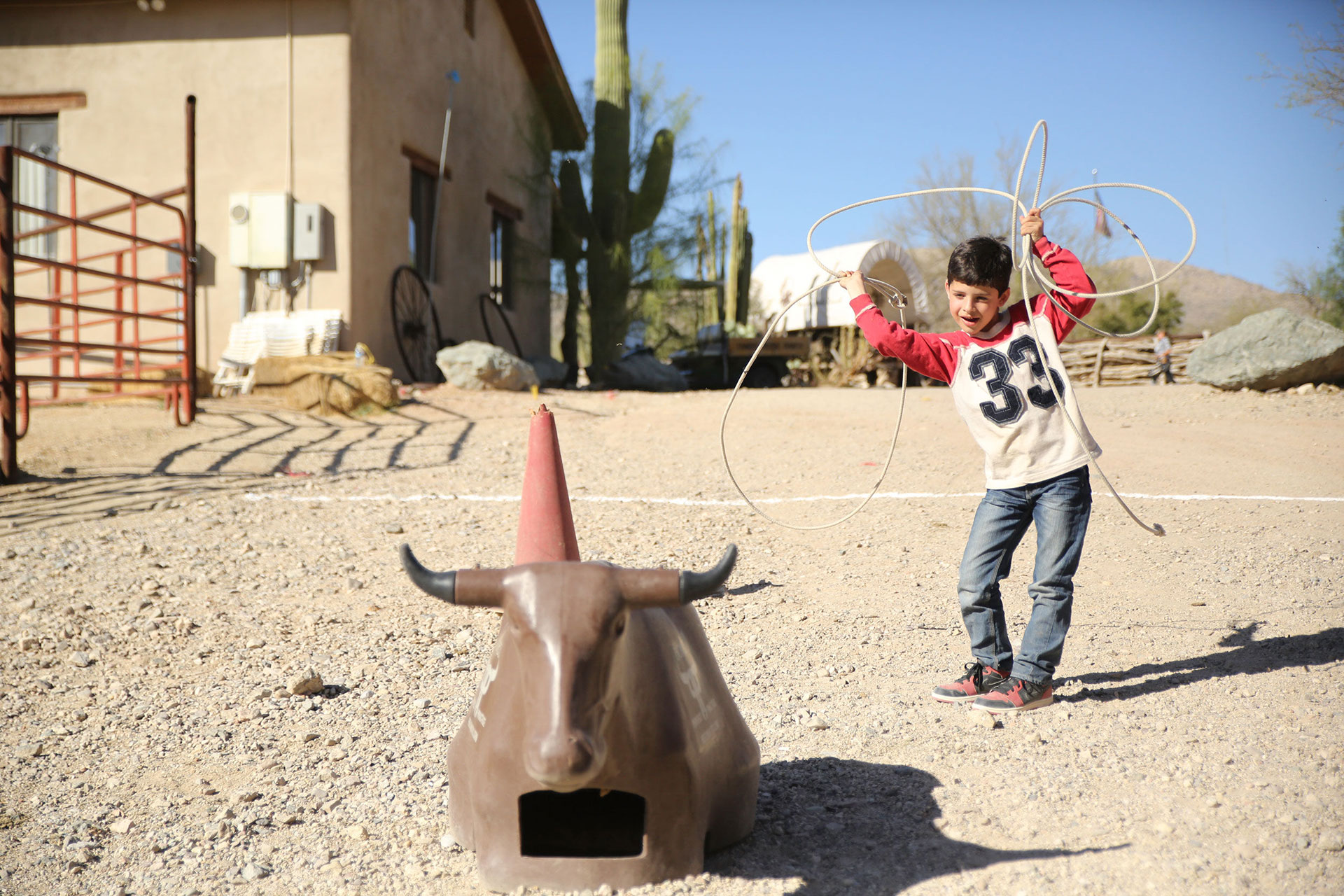 Child Learning Lasso Tricks at Tanque Verde Ranch; Courtesy of Tanque Verde Ranch