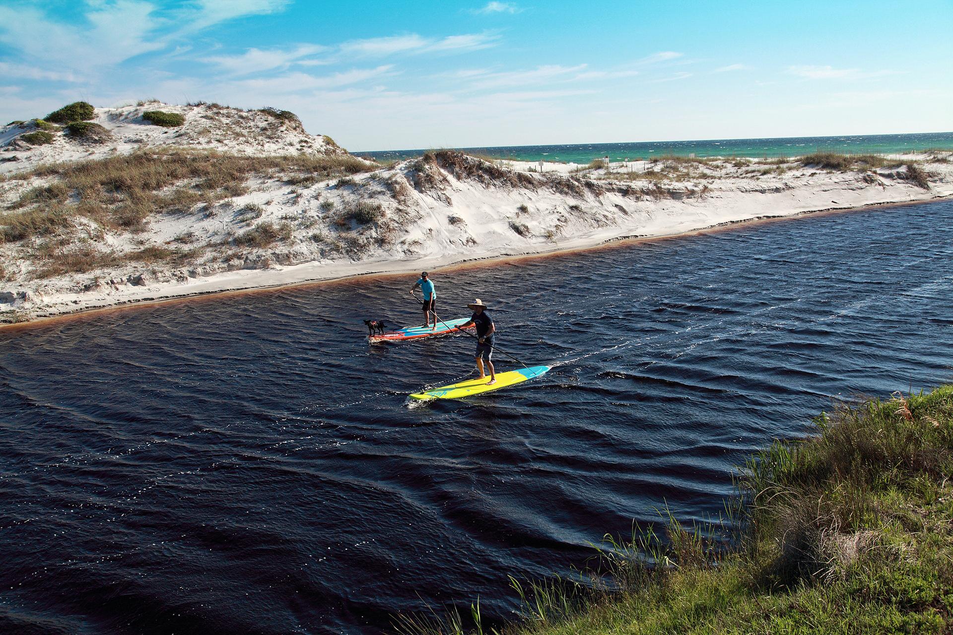 Paddleboarding on Coastal Dune Lakes in South Walton, Florida; Courtesy of Visit South Walton