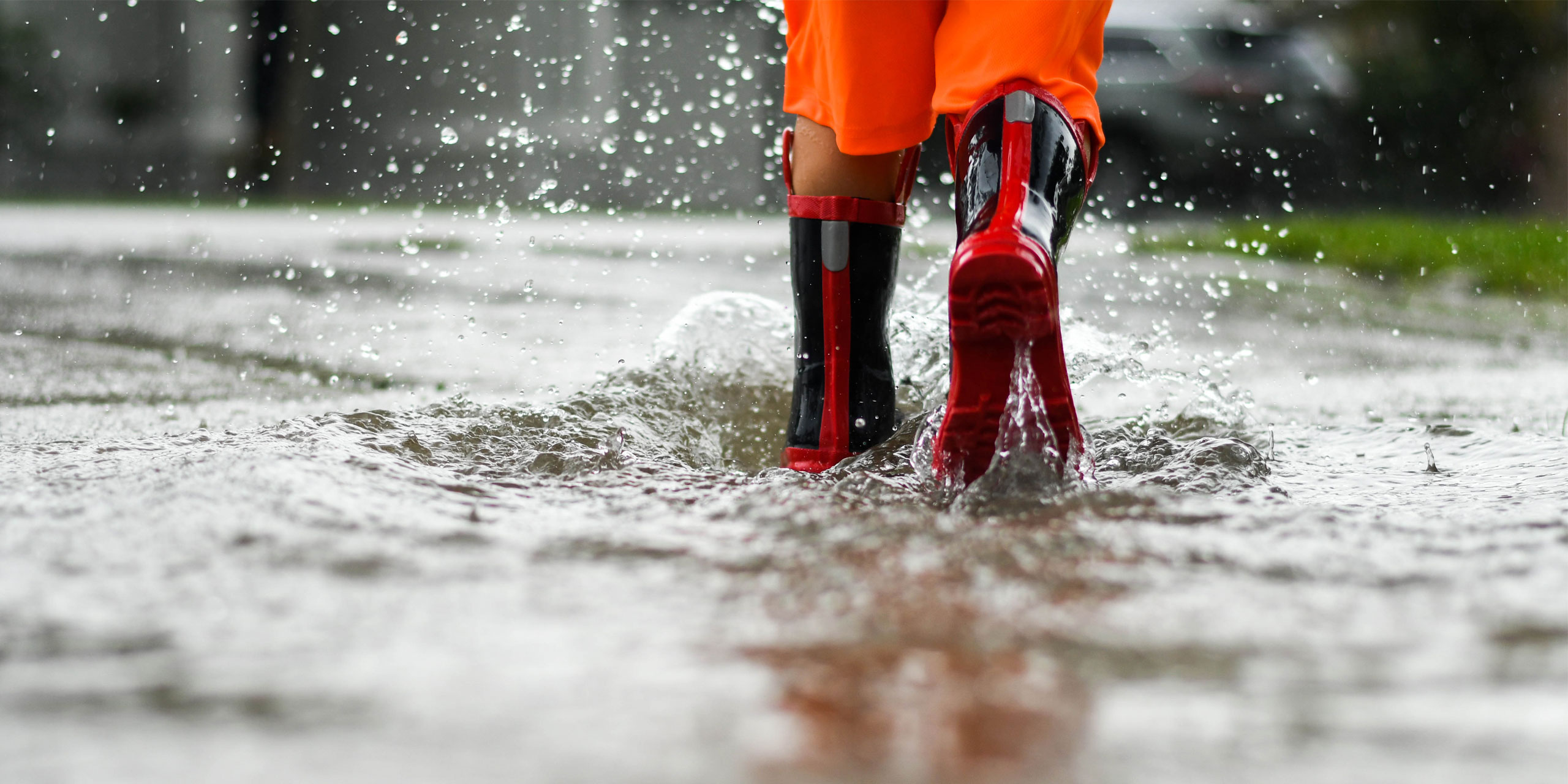 Rainboots In Rain Puddle; Courtesy of Joy Youell/Shutterstock.com