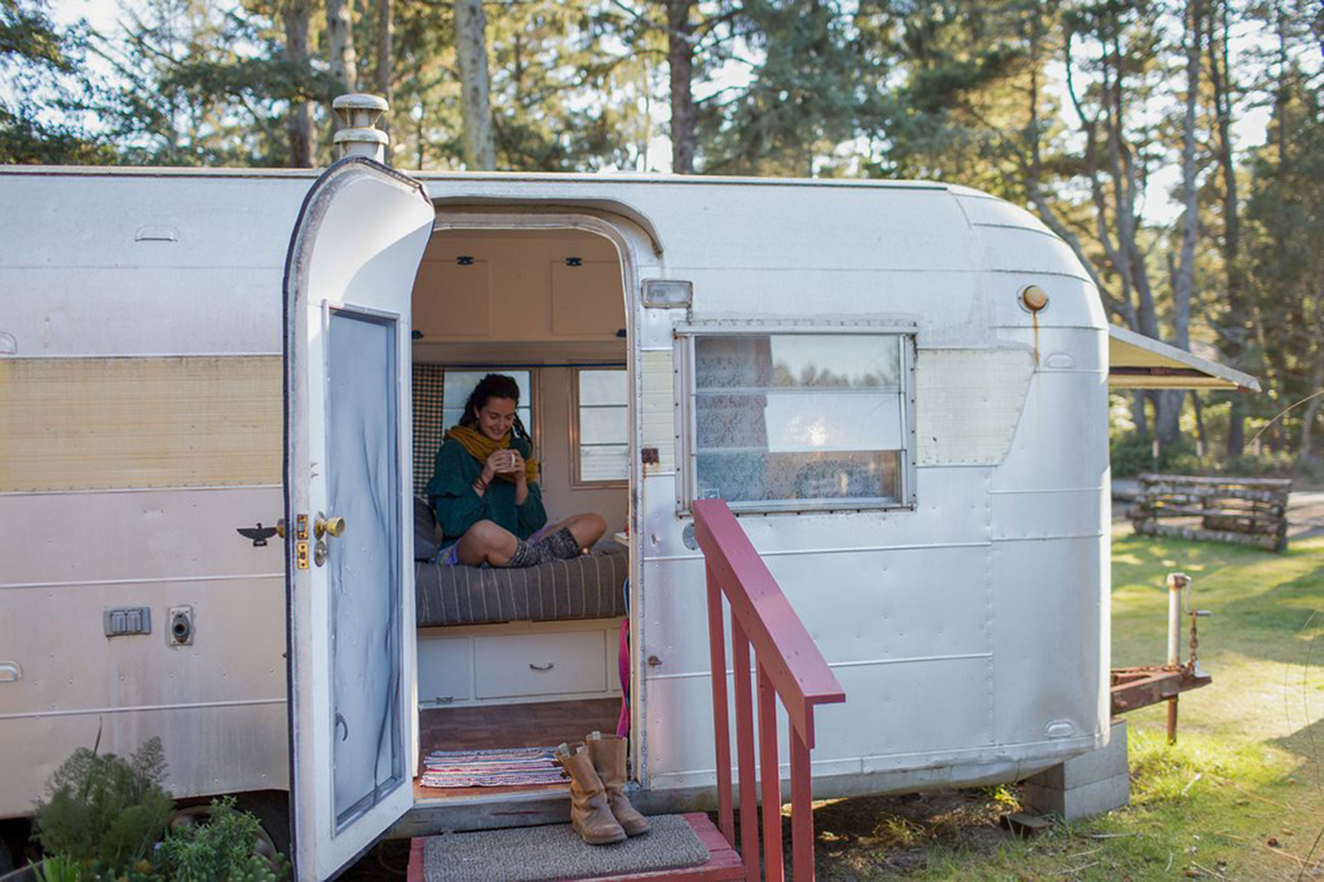 Teenage Girl in Airstream Trailer at Sou'wester Historic Lodge and Vintage Travel Trailer Resort in Seaview, Washington