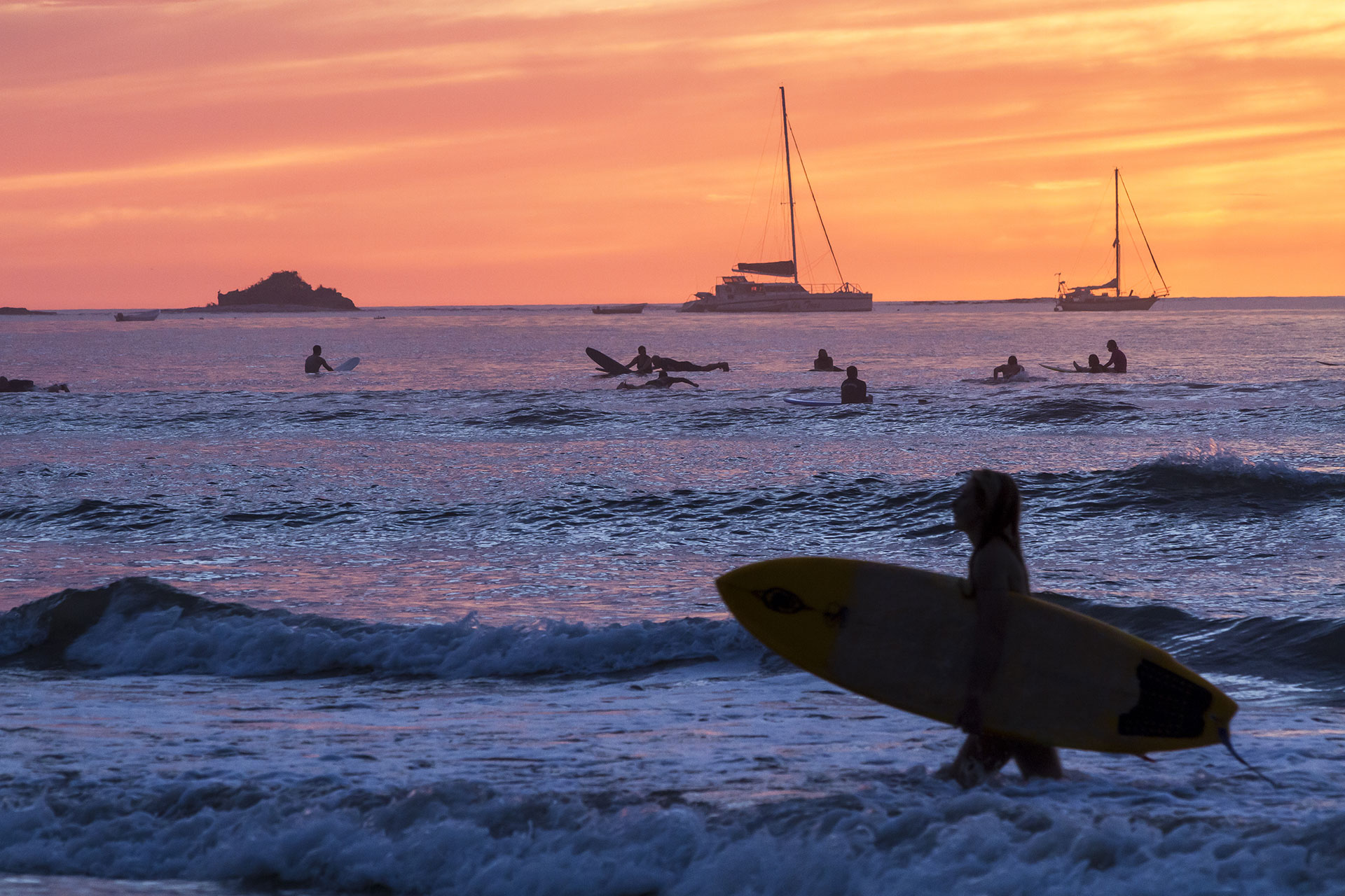 Surfing in Tamarindo, Costa Rica; Courtesy of Colin D. Young/Shutterstock.com