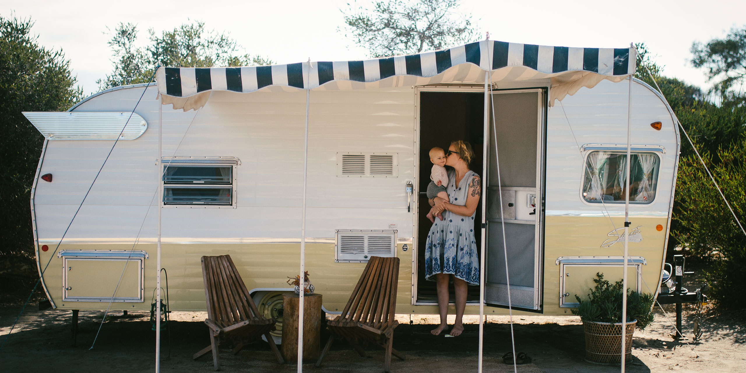 Mom and Baby in Front of Airstream Trailer at The Holidays Camp Community in San Clemente, California; Courtesy of Rebecca Kent