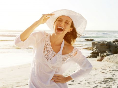 Woman On The Beach; Courtesy of mimagephotography/Shutterstock.com