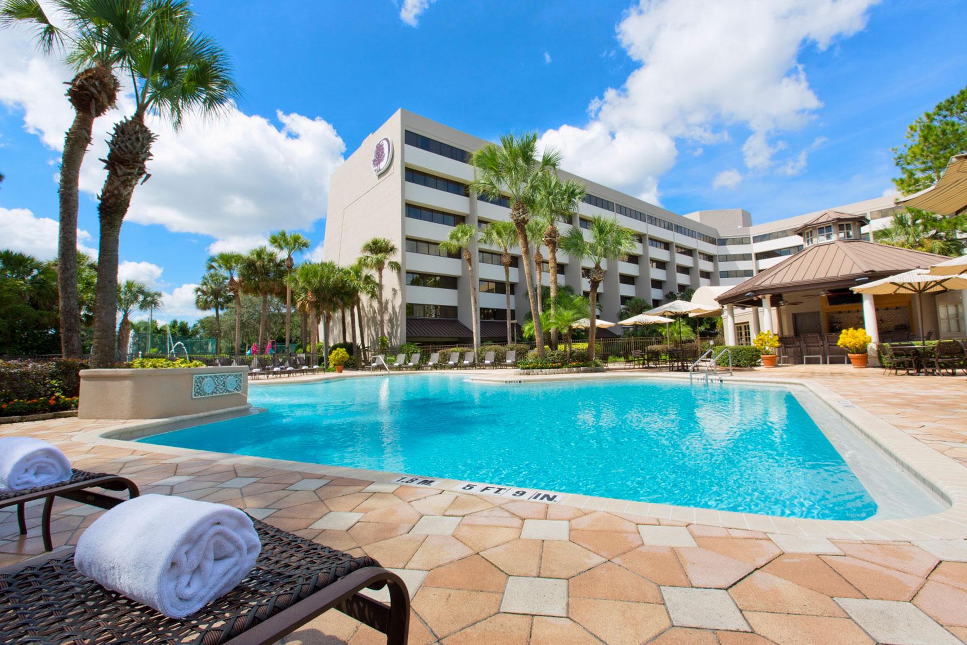 Outdoor Pool at Doubletree Suites by Hilton Hotel Orlando - Lake Buena Vista Hotel (Disney Springs Area; Courtesy of Doubletree Suites by Hilton Hotel Orlando - Lake Buena Vista Hotel (Disney Springs Area)