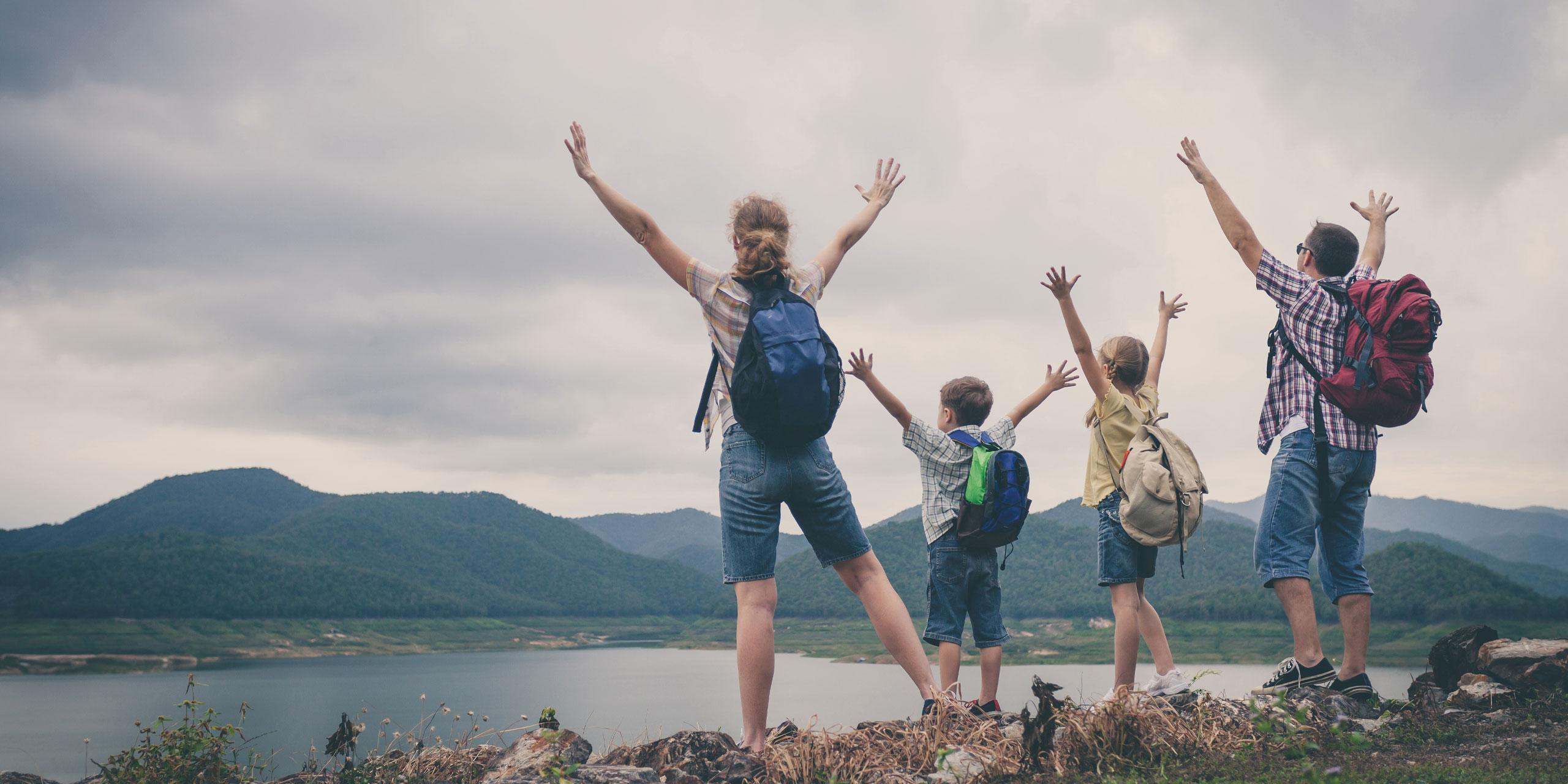 Family hiking with backpacks; Courtesy of altanaka/Shutterstock.com
