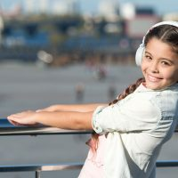 Young Girl Wearing Headphones; Courtesy of Just dance/Shutterstock.com