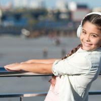 Young Girl Wearing Headphones; Courtesy of Just dance/Shutterstock.com
