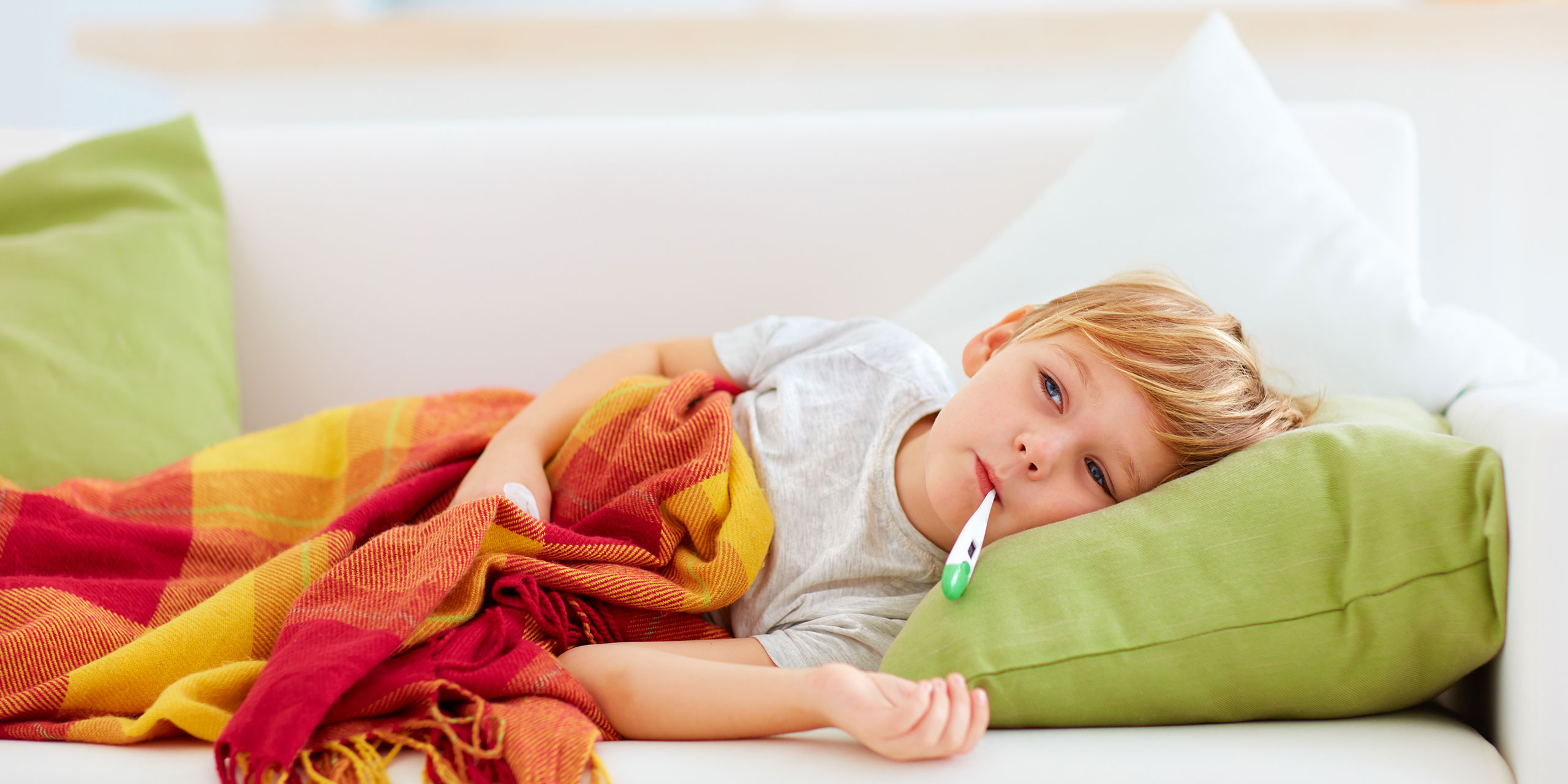 Sick Child on Sofa; Courtesy of Olesia Bilke/Shutterstock.com
