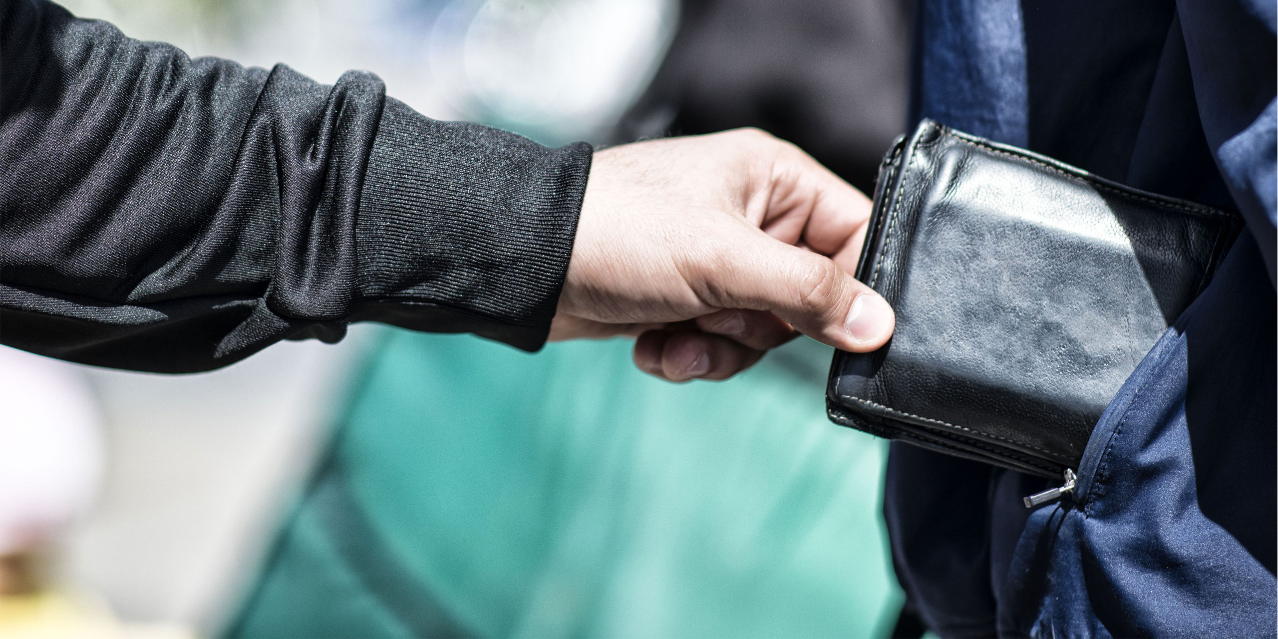 Thieve pickpocketing wallet; Courtesy of DDekk/Shutterstock.com