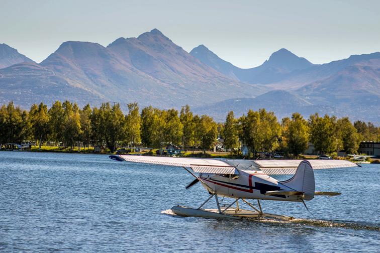 Seaplane take-off from Lake Hood Seaplane Base in Anchorage, Alaska; Courtesy of Justin Beyerlin/Shutterstock