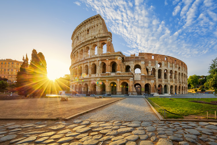 View of Colosseum in Rome and morning sun, Italy, Europe.; Courtesy of prochasson frederic/Shutterstock