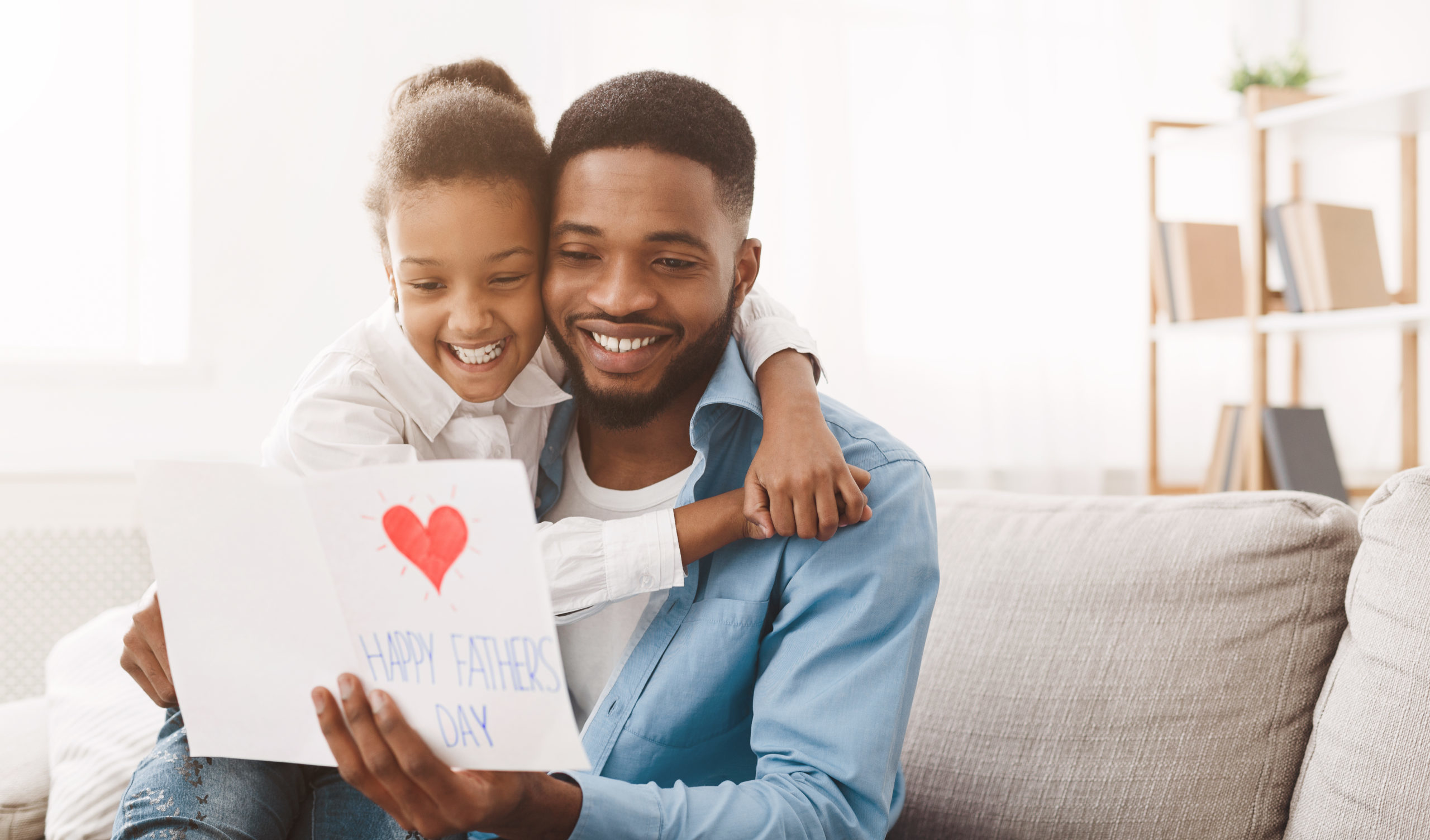 Daugher giving father a card for Father's Day