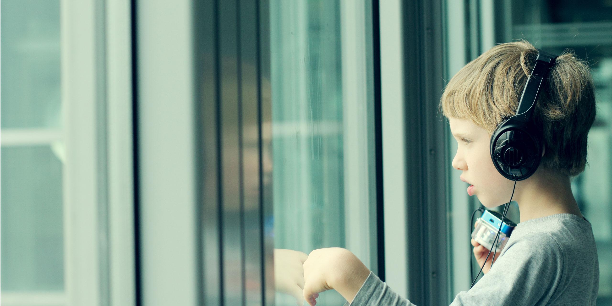 Boy Wearing Headphones; Courtesy of Dubova/Shutterstock.com