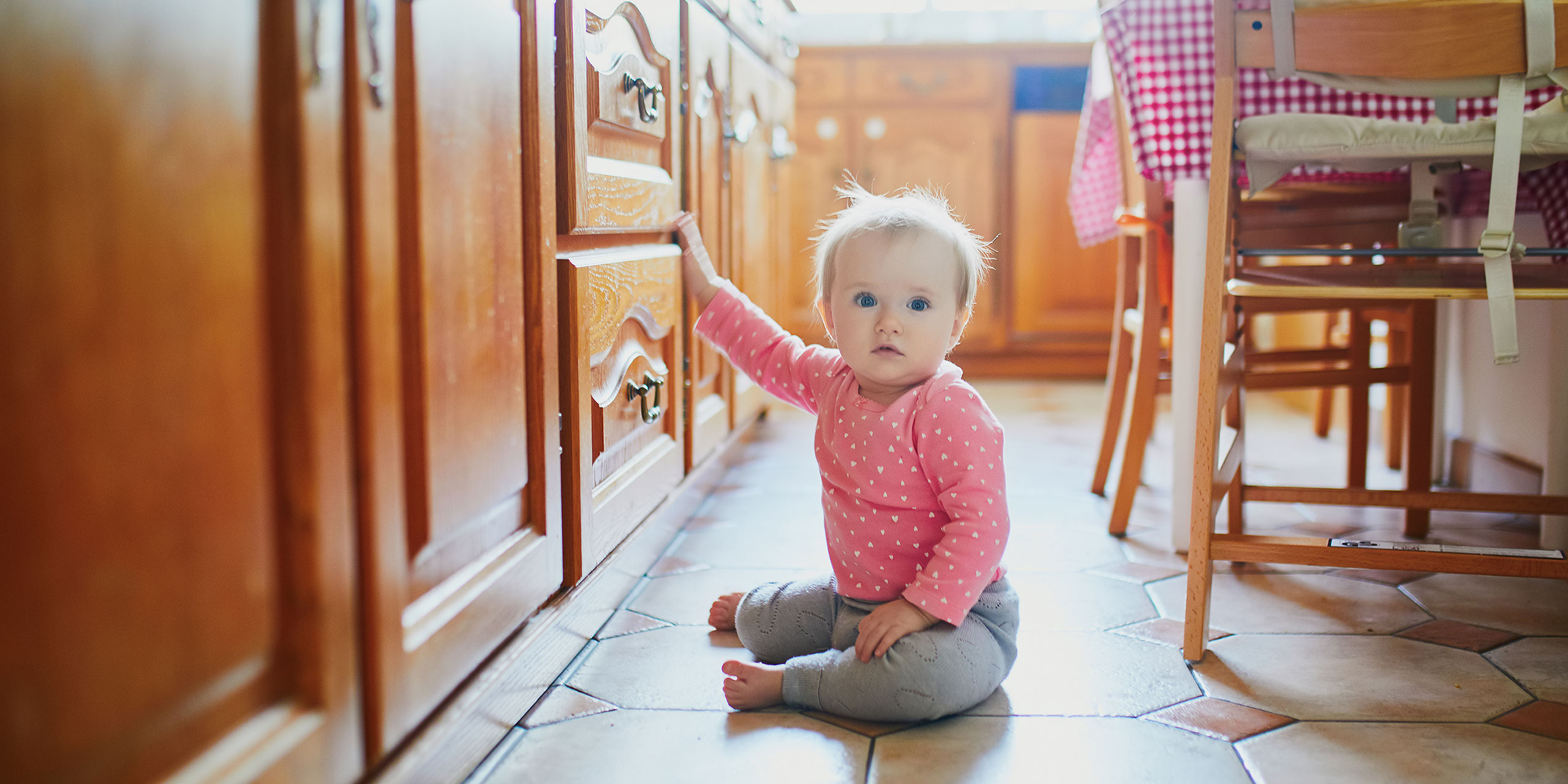 Toddler on Floor in Kitchen; Courtesy of Ekaterina Pokrovsky/Shutterstock.com