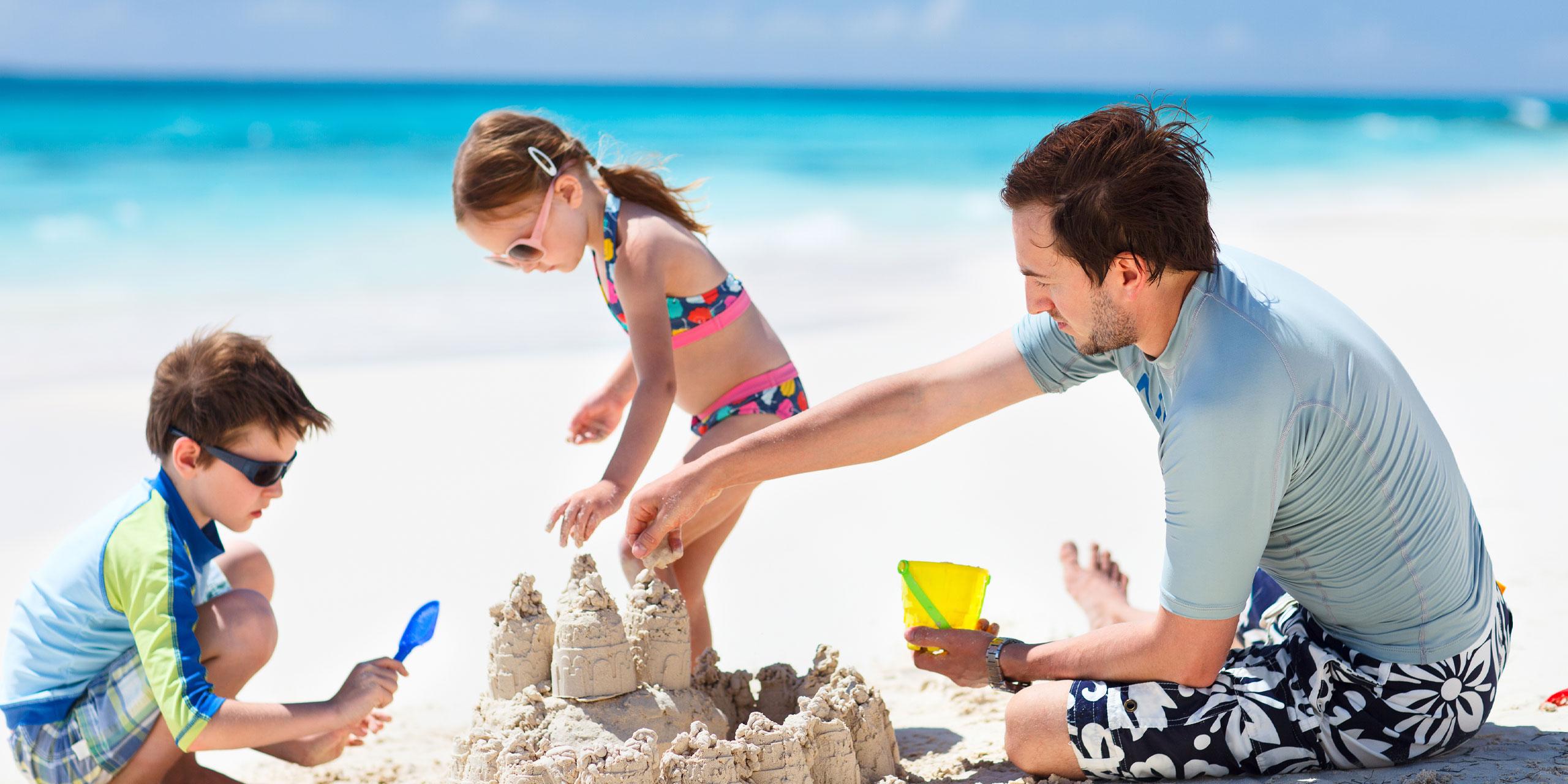 Dad Playing On Beach; Courtesy of BlueOrange Studio/Shutterstock.com