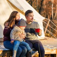 Family Glamping; Courtesy of Dmitry Zimin/Shutterstock.com