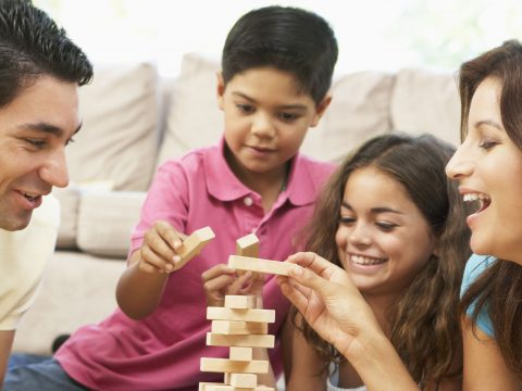 Family Playing Game; Courtesy of Monkey Business Images/Shutterstock.com