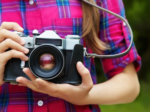 Girl with a Camera; Courtesy of Evgeny Bakharev/Shutterstock.com
