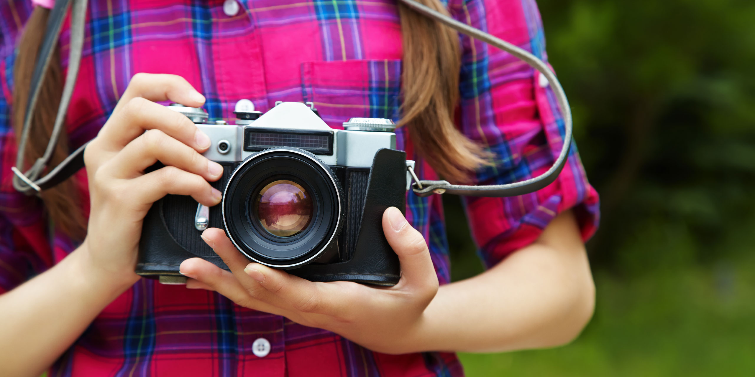 Girl with a Camera; Courtesy of Evgeny Bakharev/Shutterstock.com