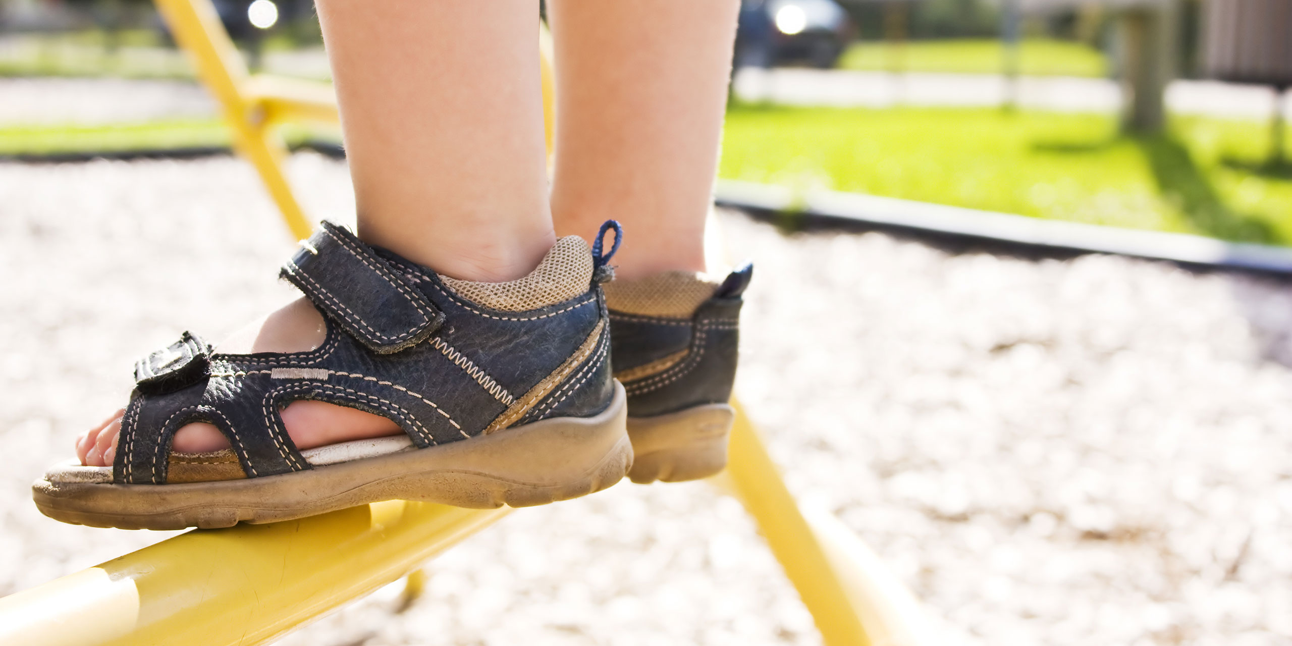 Child Wearing Sandals at Playground; Courtesy of Paul-André Belle-Isle/Shutterstock.com