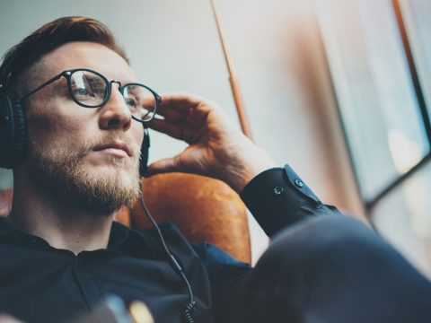 Man Wearing Headphones; Courtesy of SFIO CRACHO/Shutterstock.com