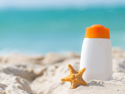 Sunscreen on Beach; Courtesy of Freebird797/Shutterstock.com