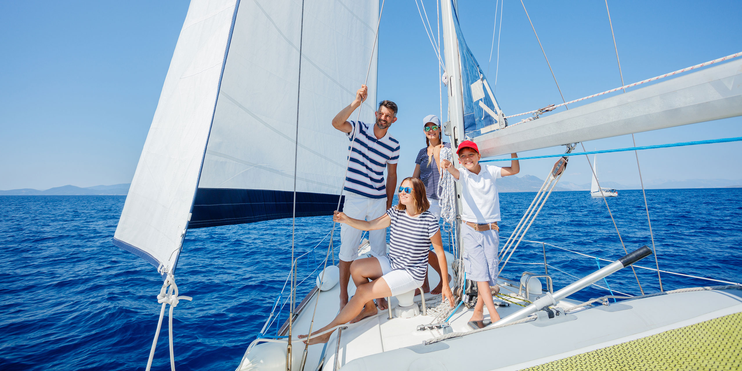 Family on Boat; Courtesy of Max Topchi/Shutterstock.com