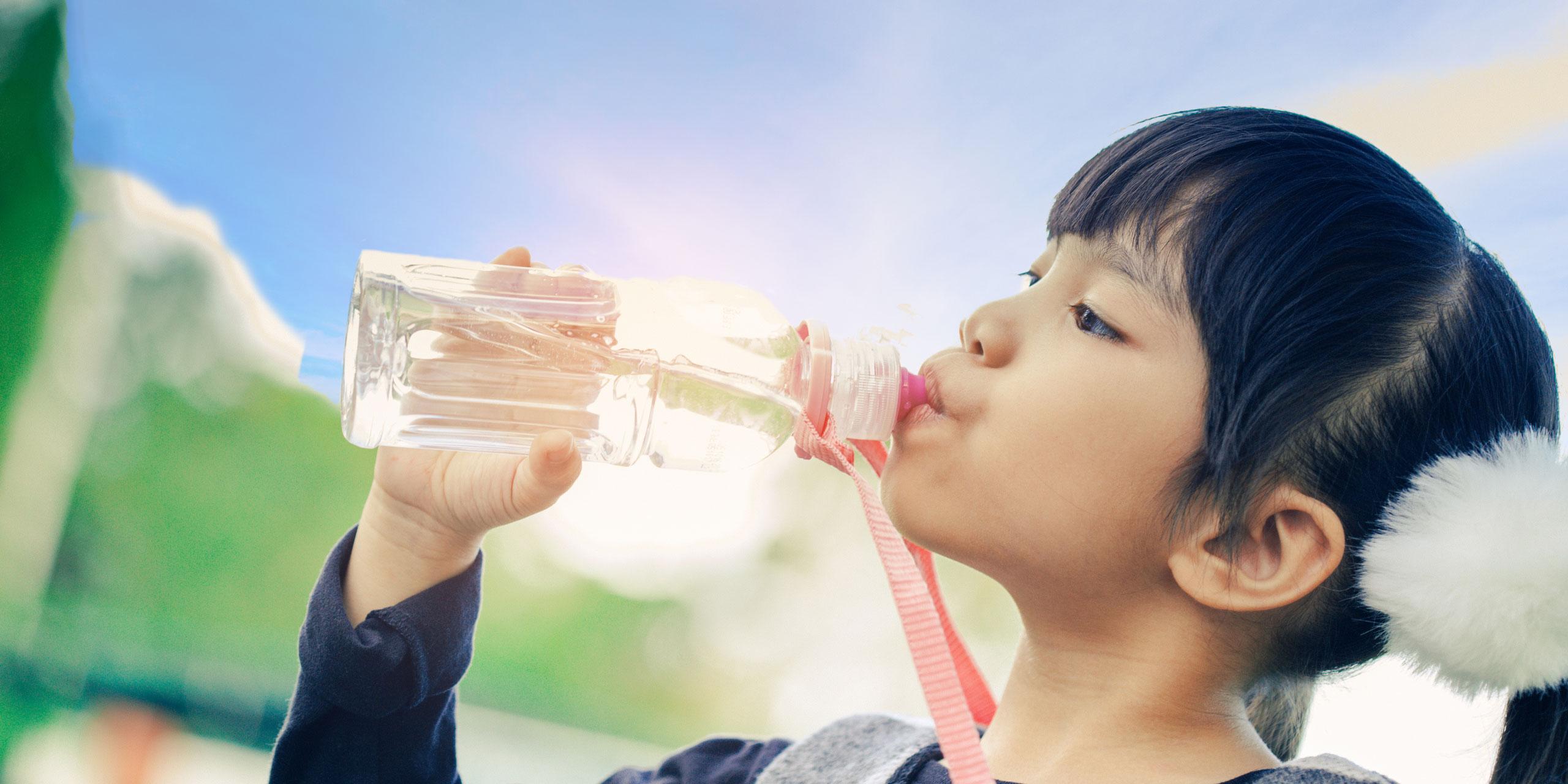 Girl Drinking Water Bottle; Courtesy of Casezy idea/Shutterstock.com