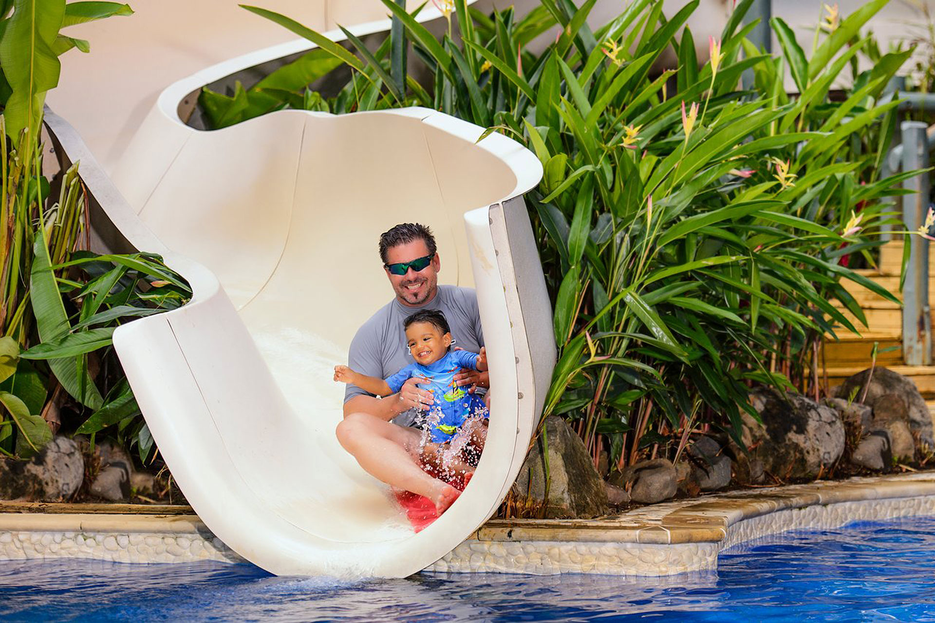 Father and Son on Waterslide at Jean Michel Cousteau Resort in Fiji; Courtesy of Jean Michel Cousteau Resort