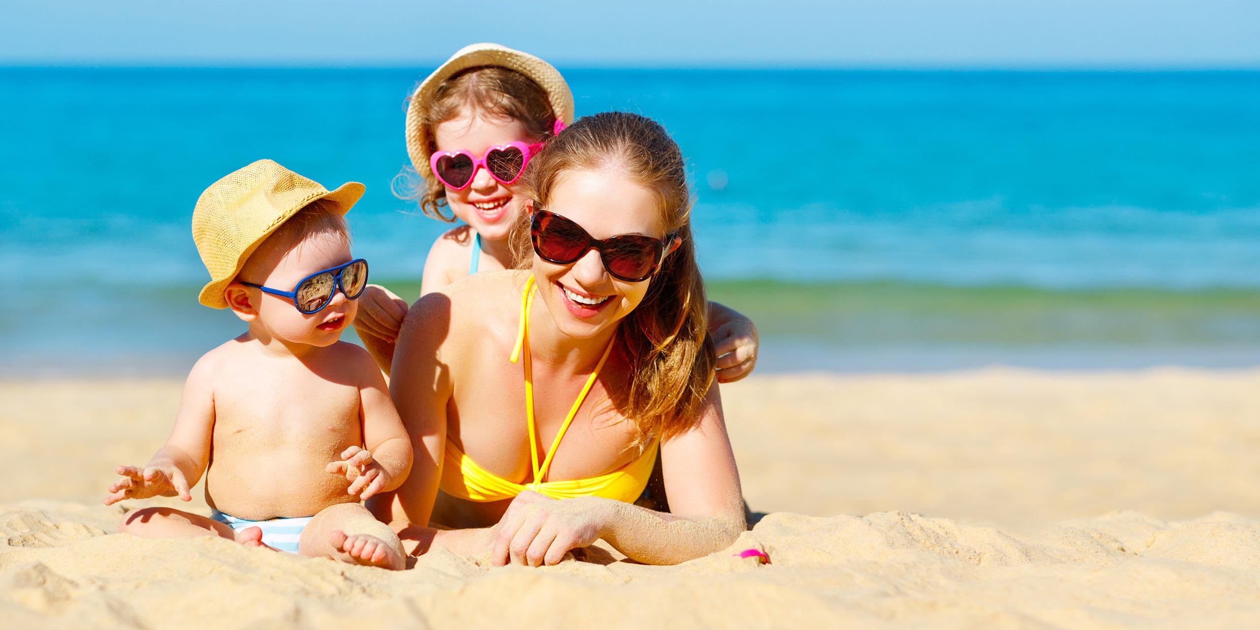 Mom and Kids on the Beach; Courtesy of Evgeny Atamanenko/Shutterstock.com