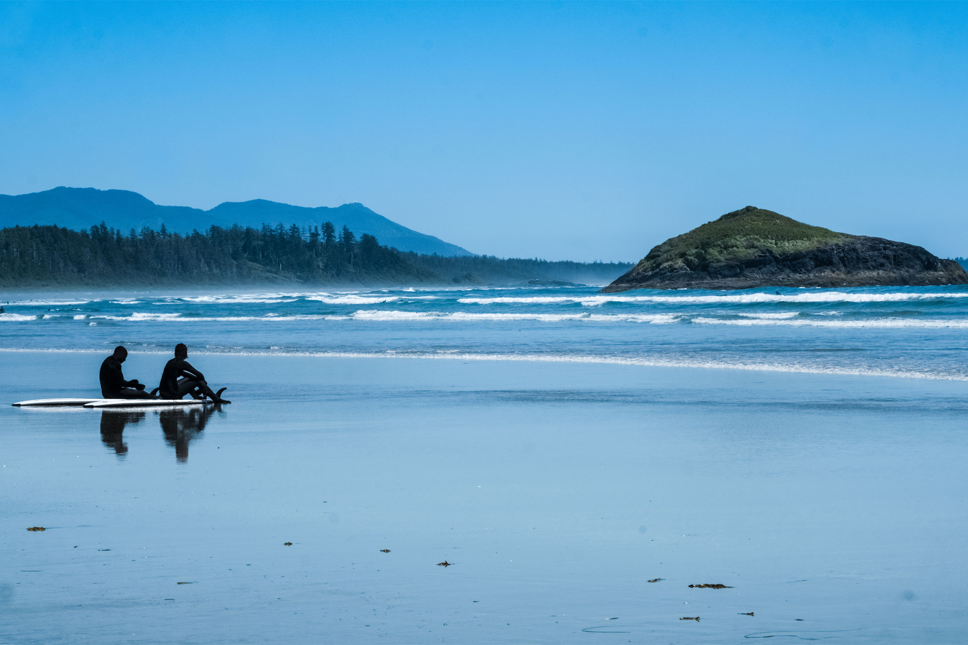 Surfing in Tofino, Canada; Courtesy of Louie Lea/Shutterstock.com