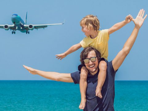 Dad and Son on Beach; Courtesy of Elizaveta Galitckaia/Shutterstock.com