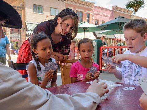 Kids Playing Cards in Deadwood, South Dakota; Courtesy of Travel South Dakota