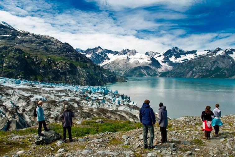 Visitors enjoying a glacier Glacier Bay National Park; Courtesy NPS