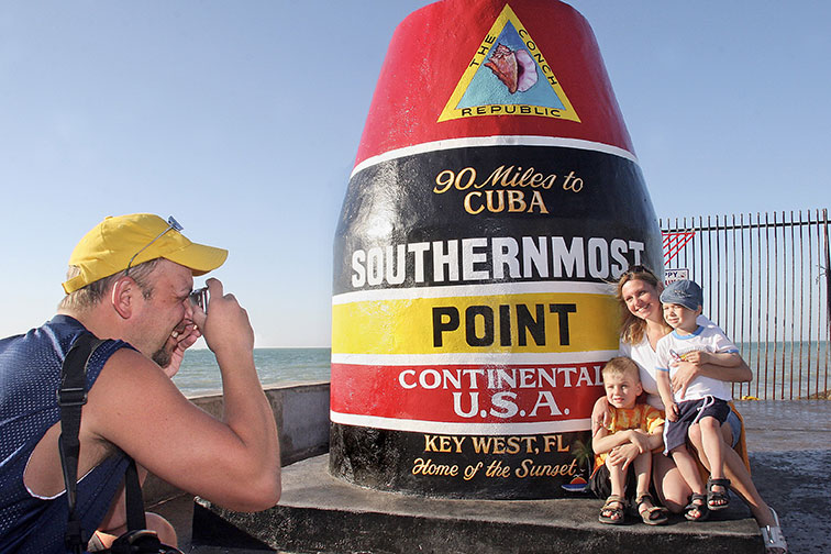 Family Posing for Photo at Southernmost Point in Key West, Florida