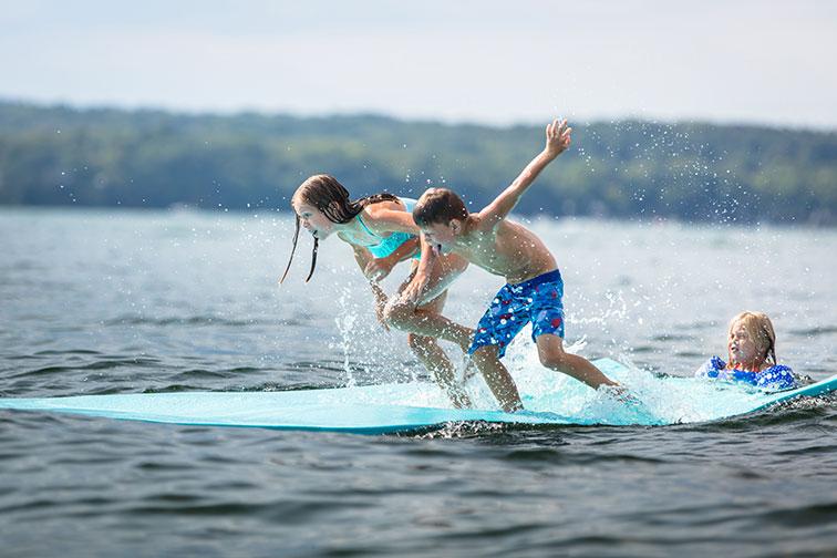 Kids Swimming in Geneva Lake in Lake Geneva, Wisconsin