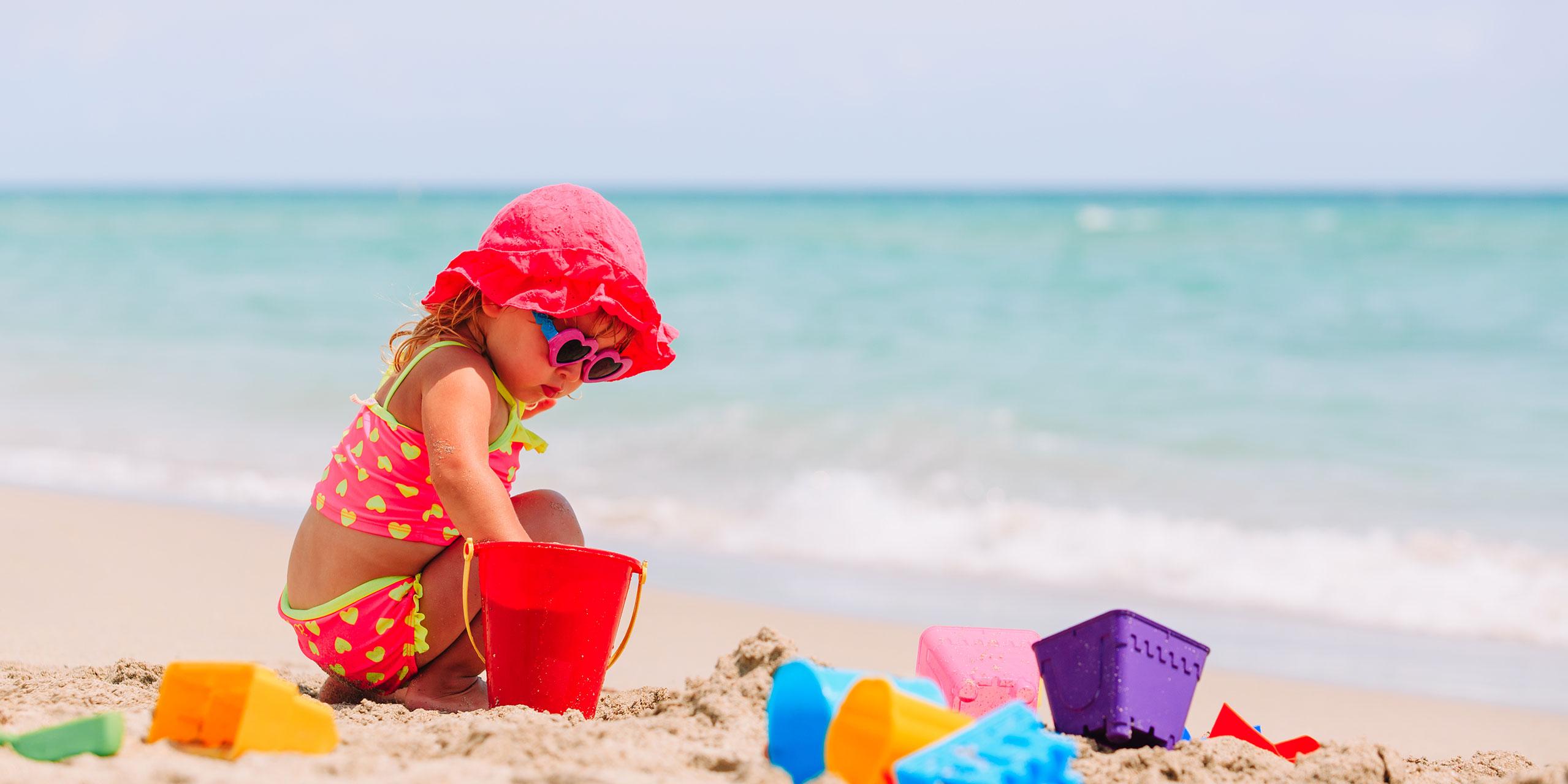 Little Girl Playing on Beach; Courtesy of NadyaEugene/Shutterstock.com
