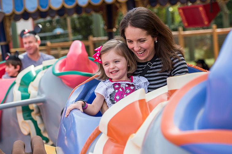 Toddler on Dumb Ride at Disney World