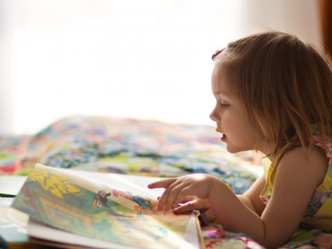 Young Girl Reading; Courtesy of Tatiana Bobkova/Shutterstock.com