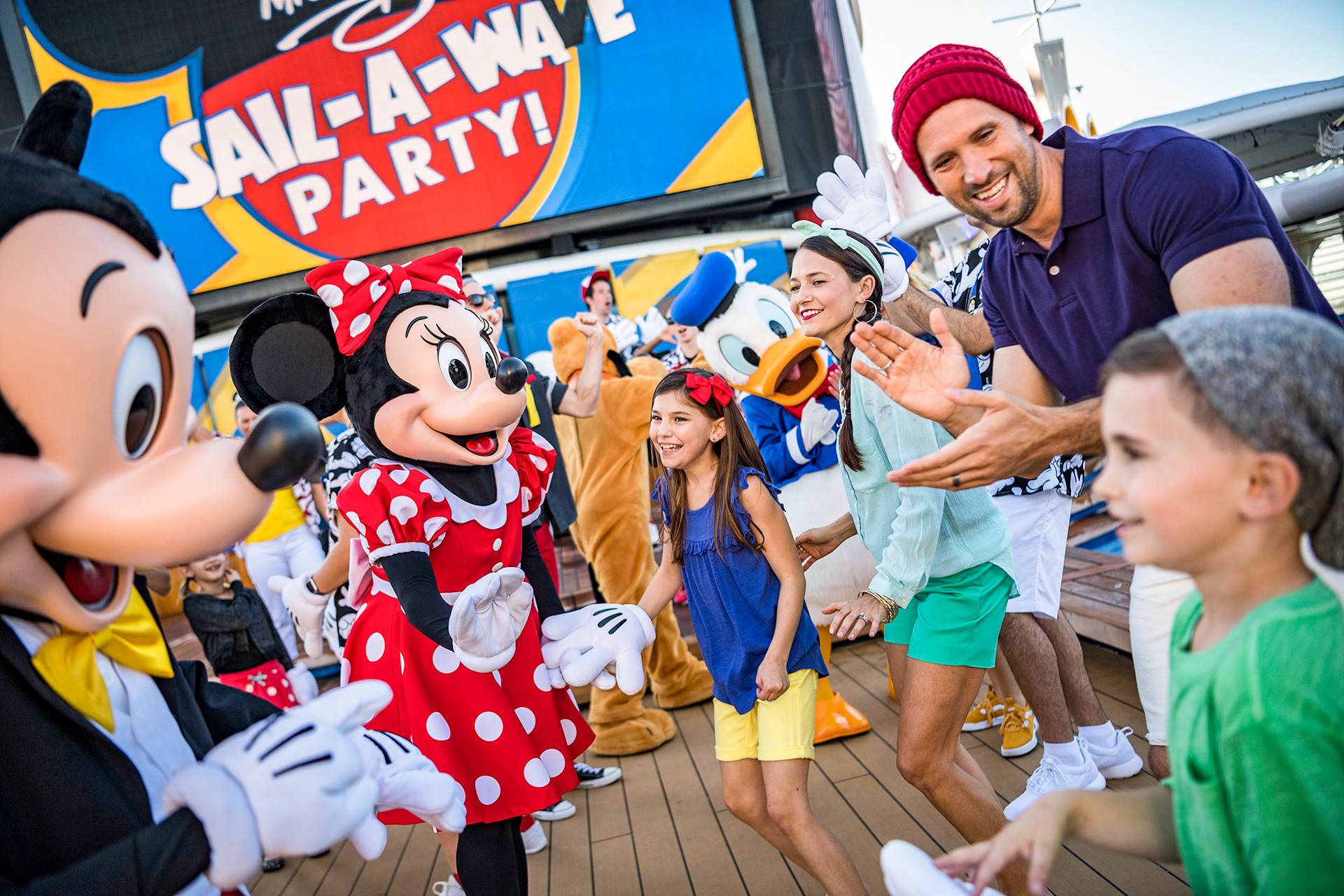 During Mickey's Sail-a-Wave Party aboard the Disney Magic and Disney Wonder, guests join Mickey, Minnie, Goofy, Pluto and Donald; Courtesy of Disney