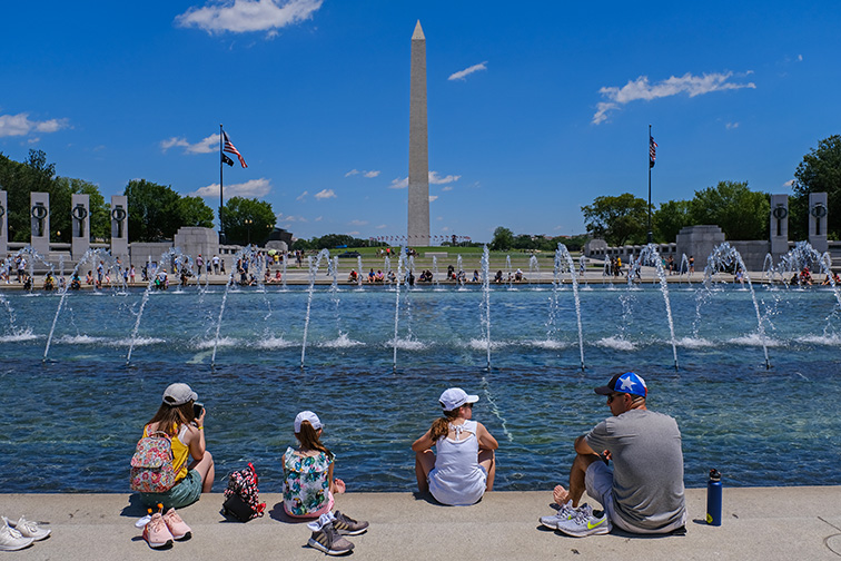 family sits on the national mall in washington, d.c.; Courtesy of Matt Smith Photographer/Shutterstock