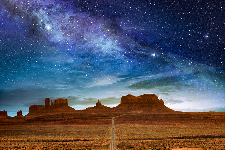 scenic route to the monument valley under a night starry sky arizona; Courtesy of paulista/Shutterstock