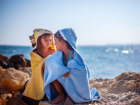 kids wearing beach towels; Courtesy of Kristina Zhuravleva/Shutterstock
