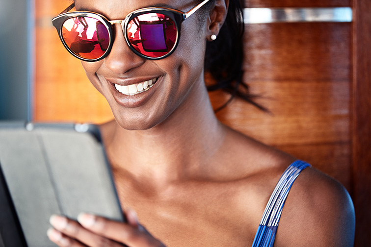 Woman Using iPad on Cruise; Courtesy of Princess Cruises