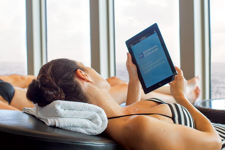 Woman Using iPad on Cruise Ship; Courtesy of Norwegian Cruise LIne