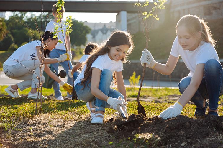 Adolescents working in volunteer group; Courtesy of Dmytro Zinkevych/Shutterstock